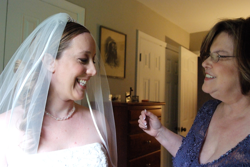 My mom and I getting ready before my wedding.