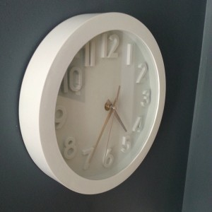 The new clock breaks up all of the dark blue on the walls
