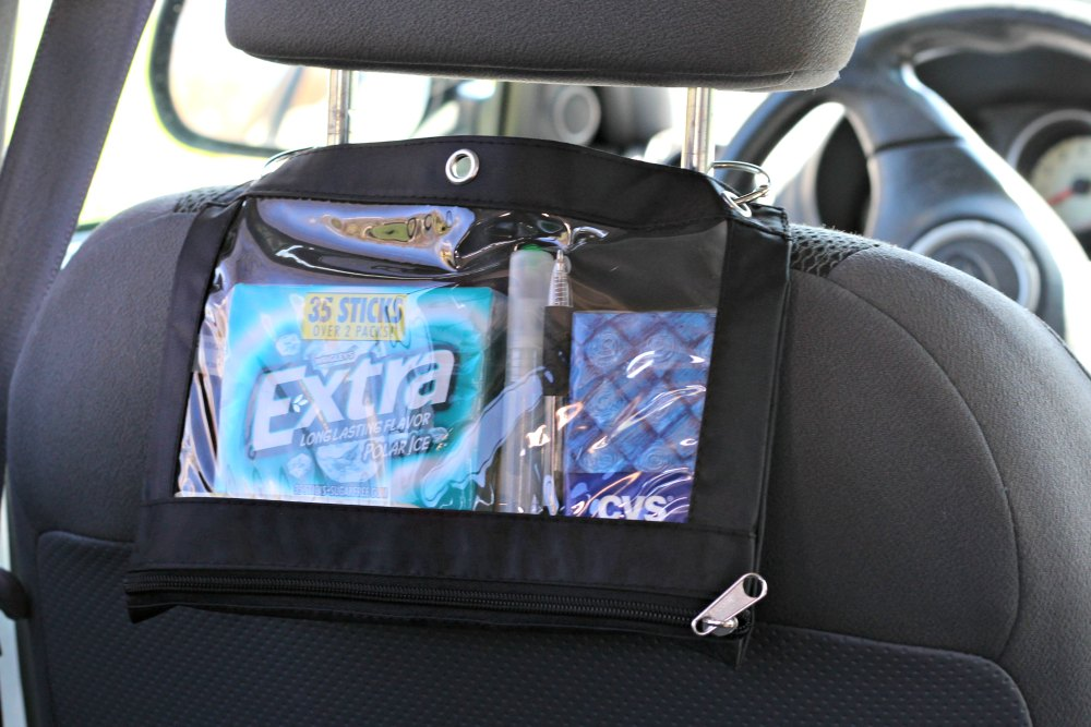 Car organizer placed on headrest for back seat access