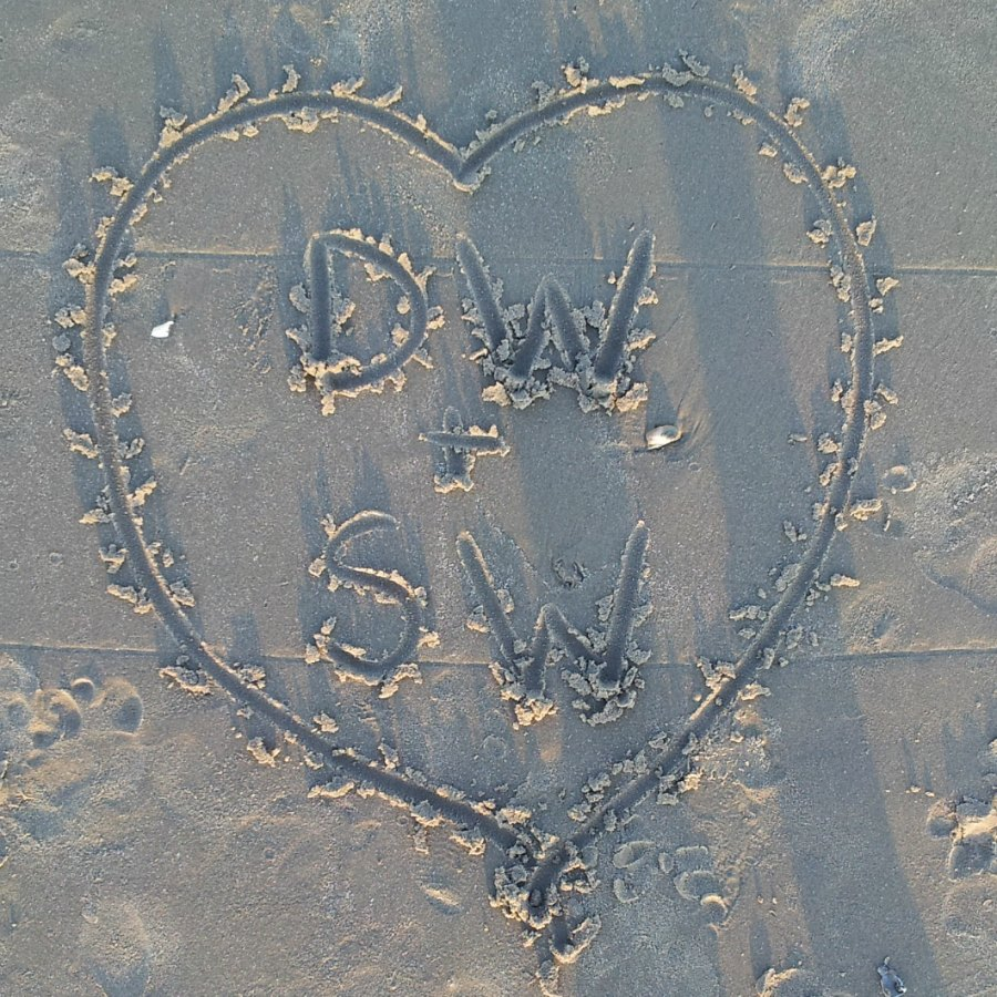 Our initials in the sand