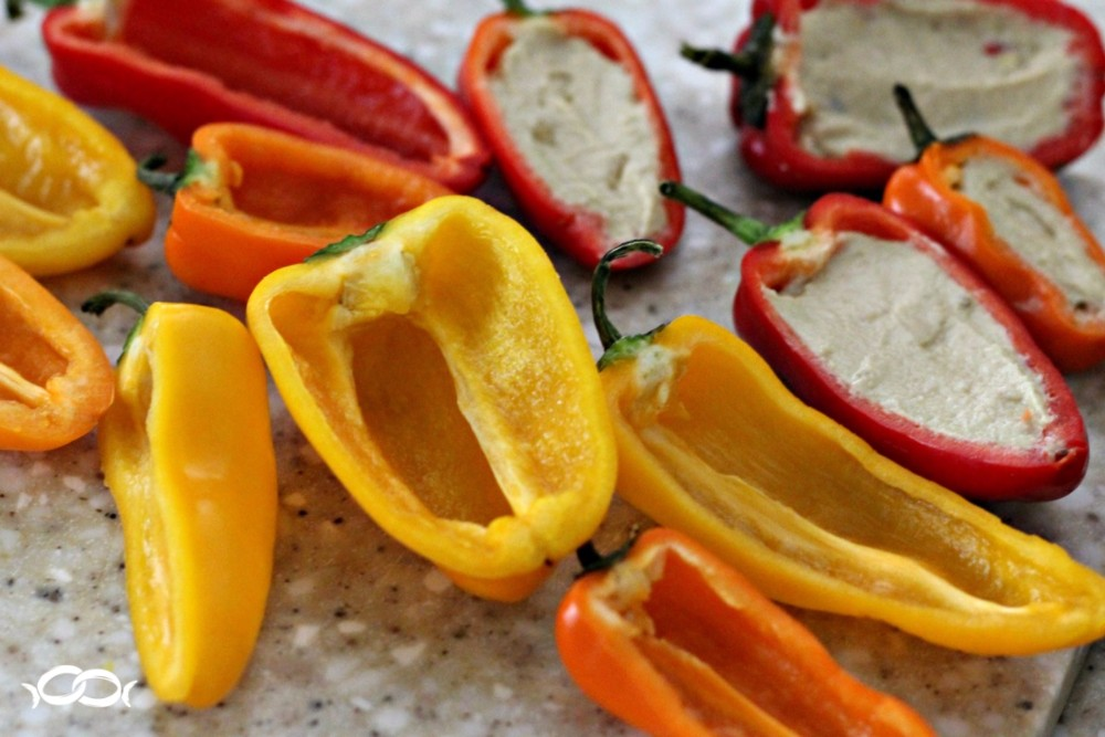 Fill halved mini peppers with hummus