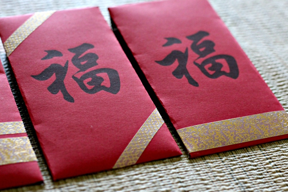 Add gold embellishments to the red pockets for Chinese New Year